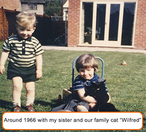 "Dominic a ""few"" years ago with our family cat ""Wilfred"""